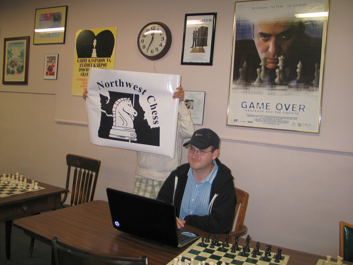 IM Ray Kaufman and the NORTHWEST CHESS banner at Portland Chess Club for May 16 BLITZ event.