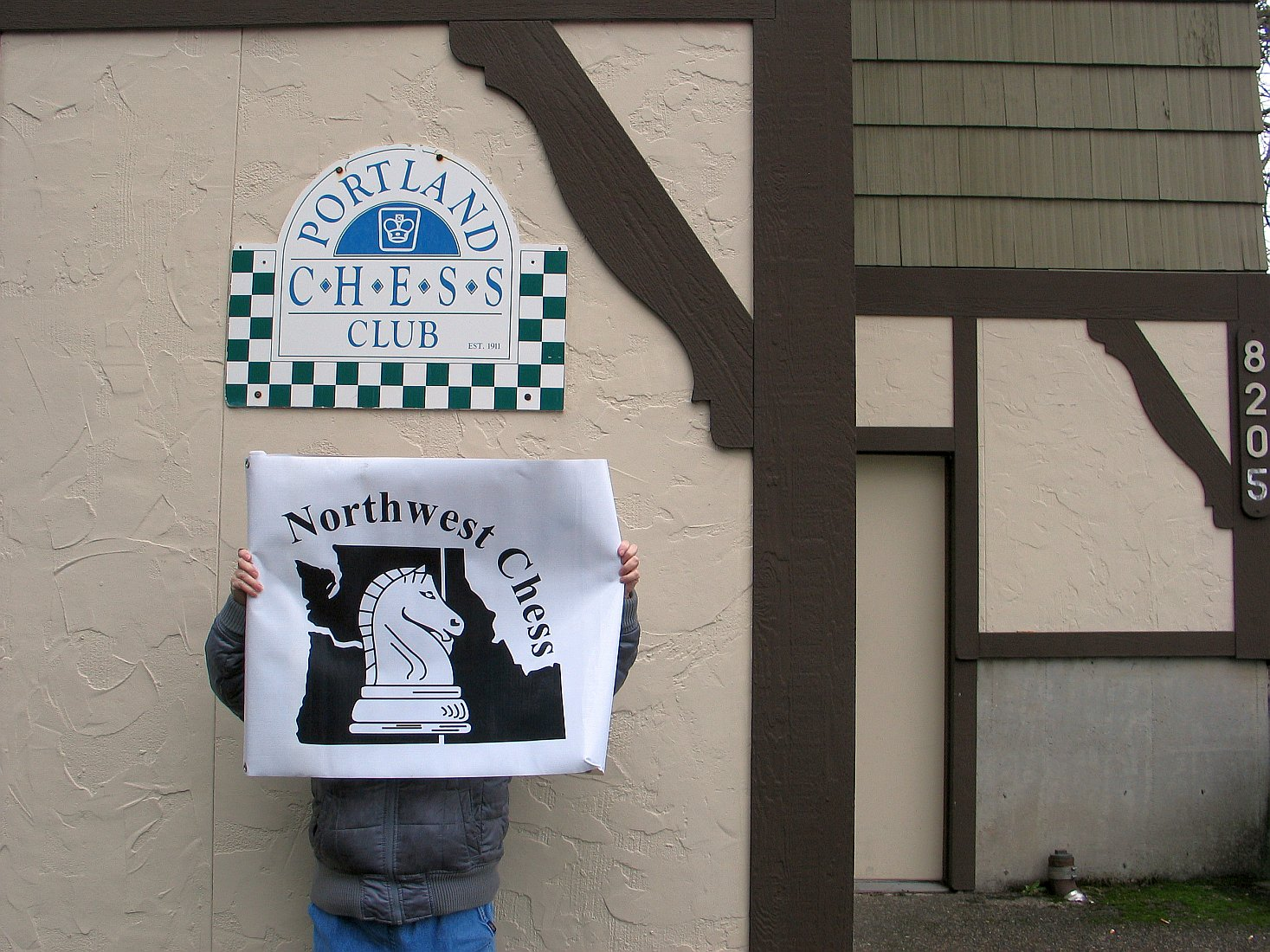 Photo Credit: Russell Miller. Kathy Miller holding NWC banner outside Portland CC.