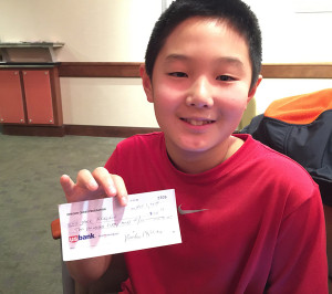 Jack Woo McClain shows prize check from Oregon Class.