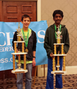 Kyle and Vikram with their bughouse trophies.